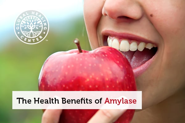 A person eating an apple. Amylase can be found in raw fruits like apple.