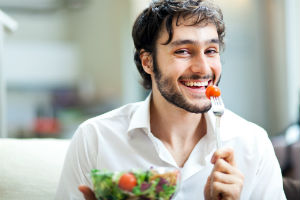 A Vegetarian Man Eating a Salad. Becoming a vegetarian can be easy if you do it in incremental steps.