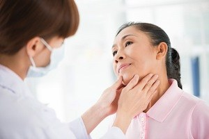 Woman getting a thyroid checkup