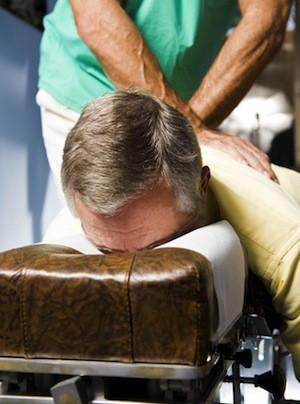 Man receiving chiropractic adjustment.