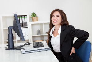 woman-at-desk-with-back-pain