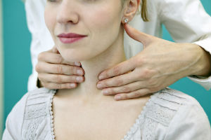 doctor-checking-female-thyroid