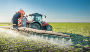 machine-spraying-pesticides-on-crops