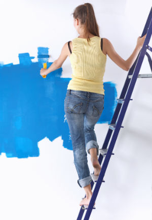 woman-painting-white-wall-blue