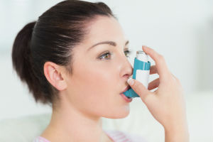 woman-using-inhaler