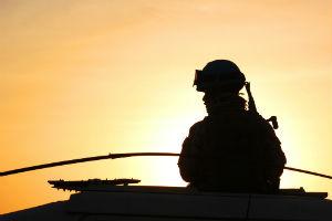 troop-silhouette-against-sky