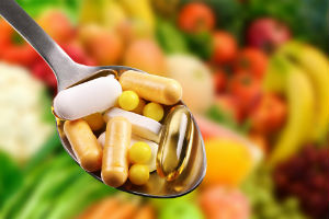 dietary-supplements-in-spoon-among-vegetables-and-fruits