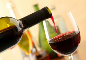 pouring-red-wine-glass