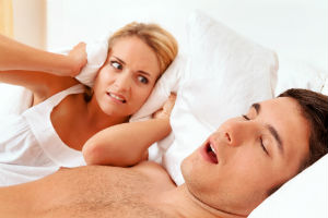 man-sleeping-snoring-woman