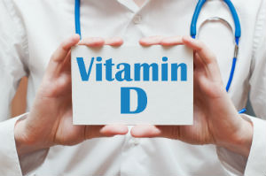 Doctor holding a vitamin D sign. Vitamin D is an essential nutrient and boasts many health benefits.