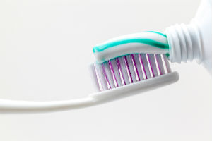 toothpaste-being-placed-on-toothbrush