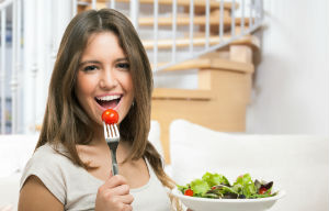 woman-eating-cherry-tomato
