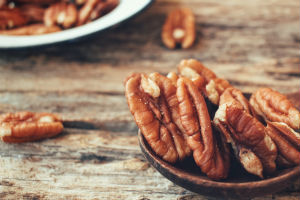 pecans-against-wooden-table