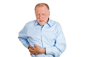 Man experiencing discomfort in his gallbladder