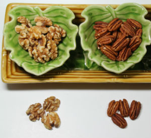 Walnuts and pecans in bowls