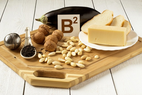 Riboflavin is a B vitamin required to metabolize fat and protein, which can be found in foods such as cheese, nuts, and bread.
