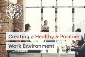 Employees having a positive work meeting. A healthy and positive work enviroment is vital for your health.