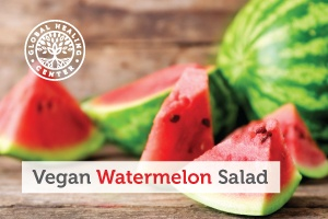 A watermelon salad is a nutritious and perfect snack for the summer. Watermelon cubes on a wooden table.