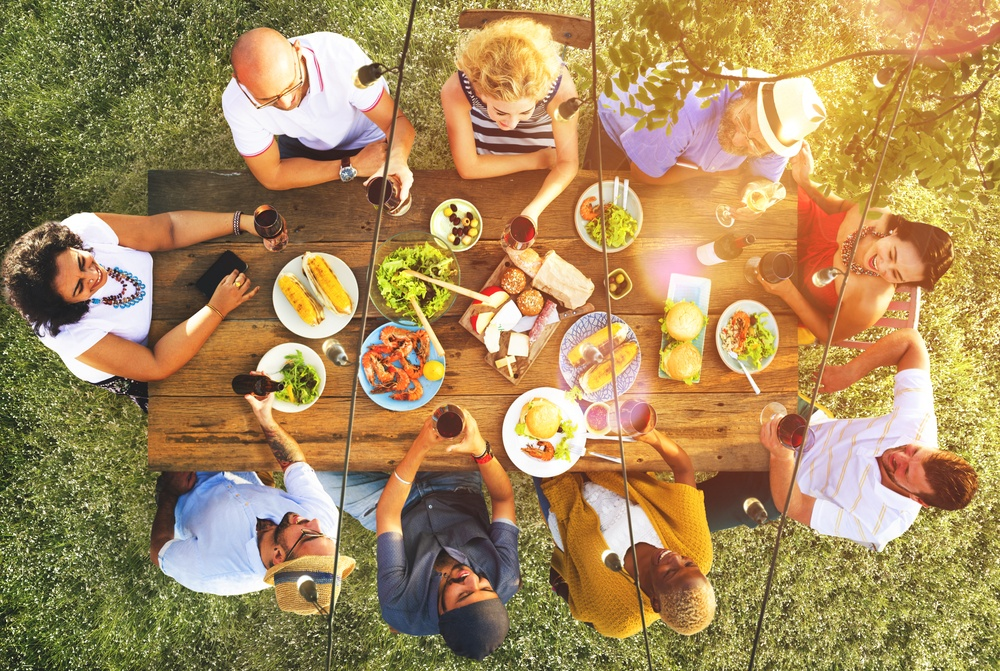 How Society Influences Diet. A group of people eating burgers and drinking alcohol.