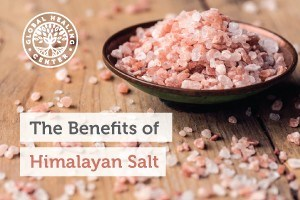 A small wooden bowl filled with Himalayan Crystal salt. This salt supports healthy respiratory function and vascular health.