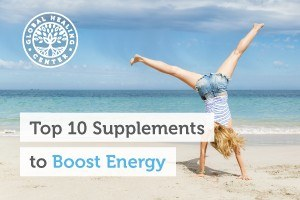A woman cartwheeling on the beach. I recommend this list of supplements such as B12 and iodine to help boost your energy.