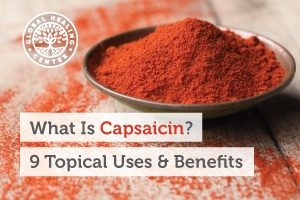A silver bowl filled with chili powder. Capsaicin is an extract that comes from chili that boasts analgesic properties.