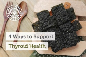 A layer of seaweed on a wooden platter. Try to drink fluoride-free water and go gluten-free to support thyroid health.