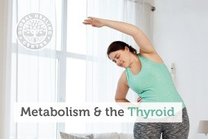 A woman is stretching in exercise attire. People with thyroid issues may have a slower metabolism which can lead to weight gain.