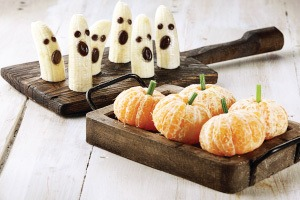Decorated fruits on a cutting board. Be aware of food dyes, a toxic chemical present in some Halloween treats.