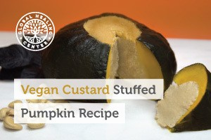 A slice of vegan custard stuffed pumpkin. This recipe is great for Halloween and much healthier than other holiday treats.