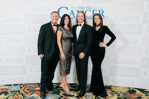 Dr. Edward Group and Dr. Daniela Group with Ty Bollinger and Charlene Bollinger at The Truth About Cancer Symposium
