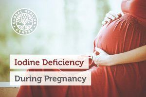 A Pregnant woman is holding her stomach. According to the AAP, 1/3 of pregnant woman encounter mild iodine deficiency.