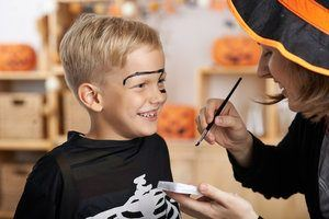 A boy getting his face painted. Some Halloween makeup kits may contain unsafe ingredients that can be toxic.