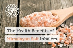 Himalayan Salt on a wooden spoon. The Himalayan Salt Inhaler has many benefits of salt-air therapy and other health benefits.