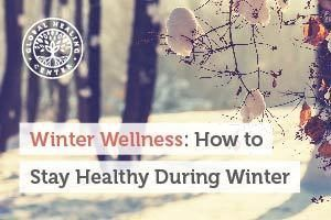 A tree covered with snow. There are several ways to stay healthy during winter like exercising and eating right.