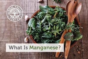 A bowl of organic green salad. Manganese is a critical mineral that is both nutritionally essential and beneficial.