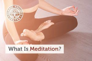A women is practicing meditation. Meditation relaxes the mind and switches the body into the parasympathetic state.