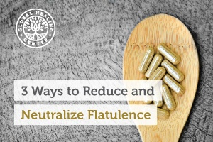 A wooden spoon full of supplements. Herbal supplements are one of the best ways to help reduce flatulence.