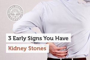 A person holding his lower back area. Most kidney stones pass through the urinary tract with no trouble.