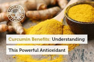 A spoon full of turmeric. Curcumin benefits include antioxidant support.