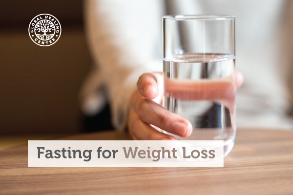 A glass full of water. There are many benefits that come from fasting for weight loss.