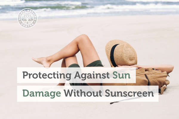 An individual on a beach relaxing. A good way to protect yourself against sun damage is to stay in the shade.