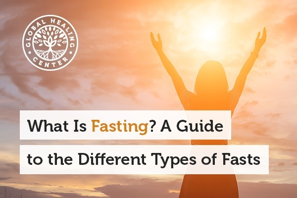 A woman staring at the sun. Understanding what fasting is and the different types can be very beneficial for your health.