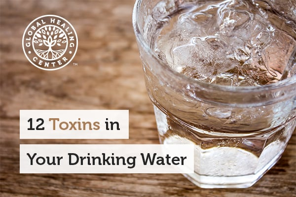 Glass of water sitting on a table. There can be many toxins in your drinking water that can negatively impact your health.