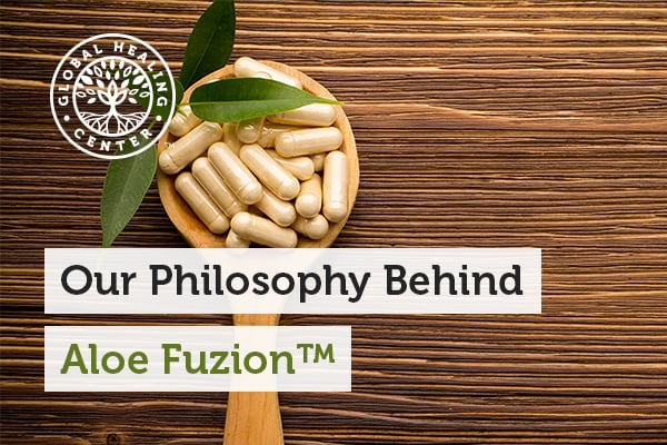 Aloe Fuzion™ capsules on a wooden spoon. Aloe Fuzion is an aloe vera supplement with the highest amount of acemannan.