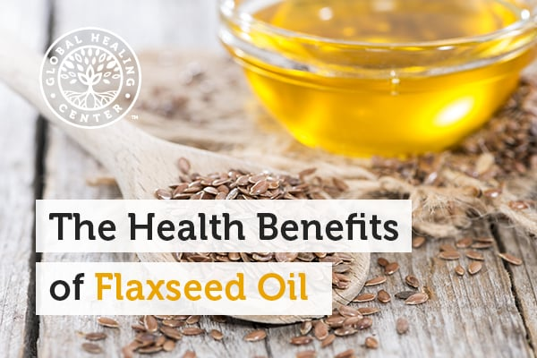 A Wooden spoon filled with flaxseeds. Flaxseed oil has been found to be beneficial for those who suffer from high cholesterol.