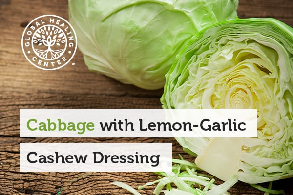 A cabbage cut in half. Cabbage is a nutrient-rich alkaline food, which can serve to prepare delicious vegan recipes.
