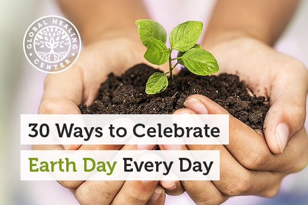 A person holding soil. Planting a tree is a simple way to support Earth Day.