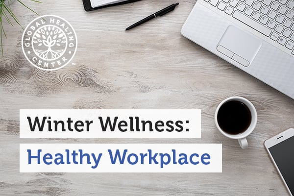 A laptop on a desk. A healthy workplace during winter is about having healthy work habits and avoiding germs and microbes.