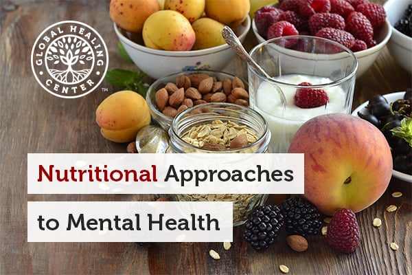 Table full of healthy foods that can be consumed as nutritional options to maintain mental health.